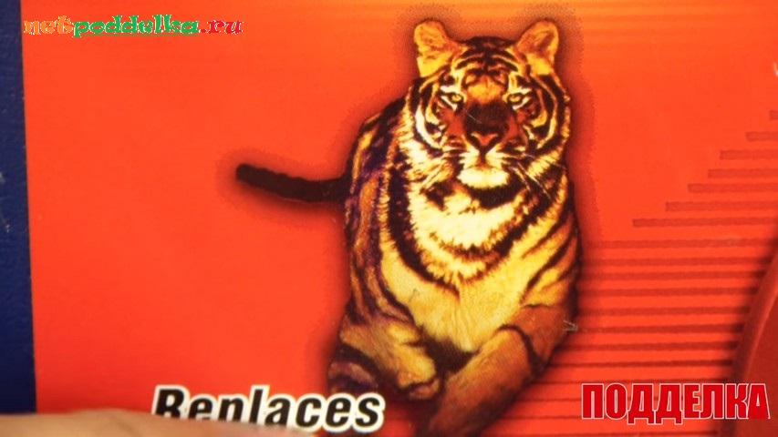 Резкие обрывы линий и тень у тигра